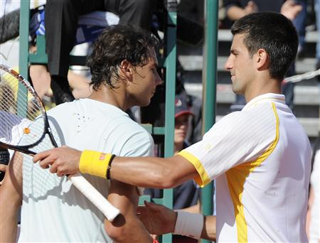 Novak Djokovic of Serbia shakes hand with Rafael Nadal of Spain after the final match of the Monte Carlo Masters in Monaco