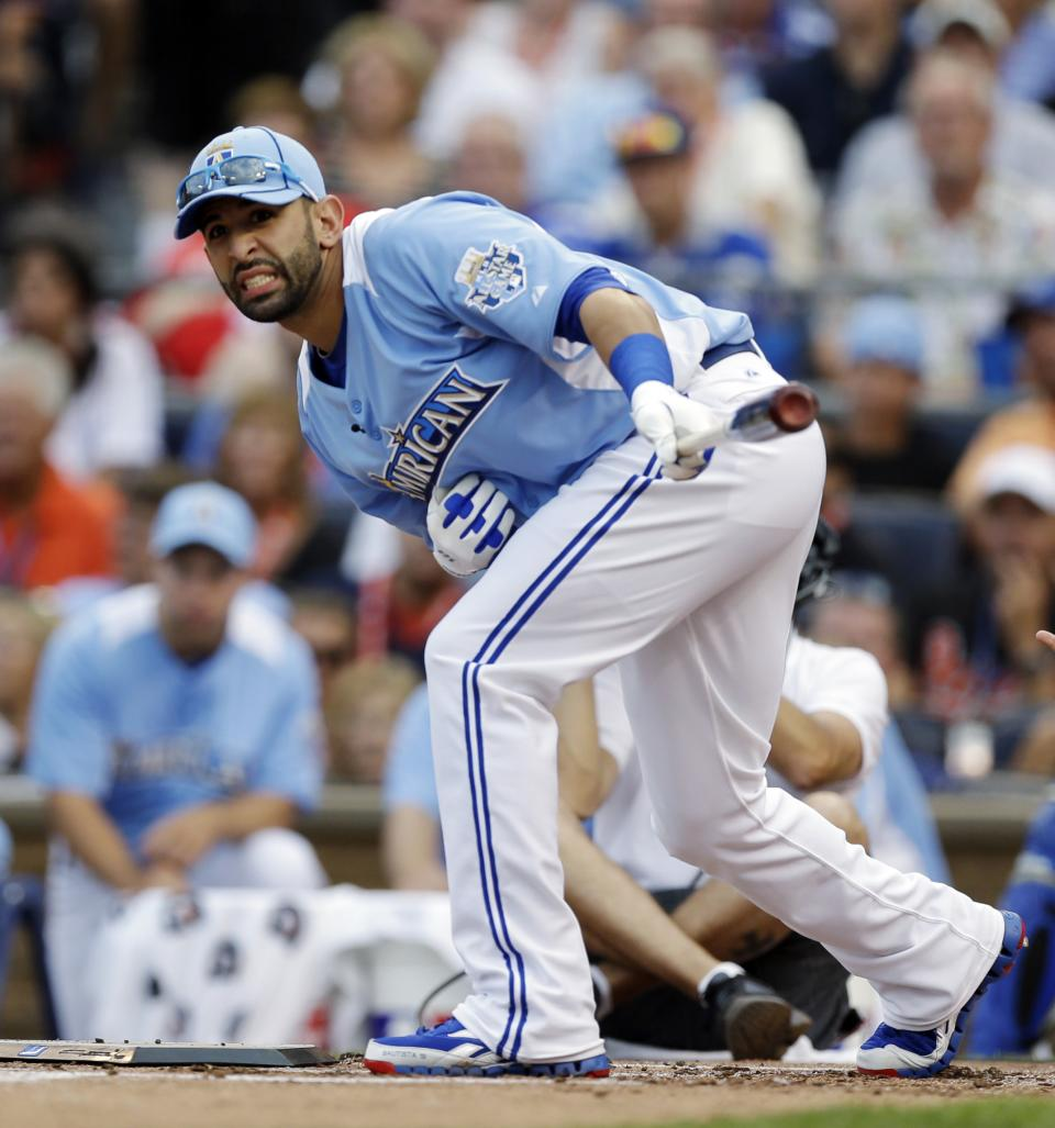 American League's Jose Bautista, of the Toronto Blue Jays, reacts during the MLB All-Star baseball Home Run Derby, Monday, July 9, 2012, in Kansas City, Mo. (AP Photo/Jeff Roberson)