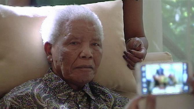 FILE - In this file image taken from video, the ailing anti-apartheid icon Nelson Madela is filmed Monday April 29, 2013, more than three weeks after being released from hospital. The office of South Africa's president said Saturday, June 8, 2013 that Mandela has been taken to a hospital because of a lung infection. (AP Photo/SABC TV) SOUTH AFRICA OUT