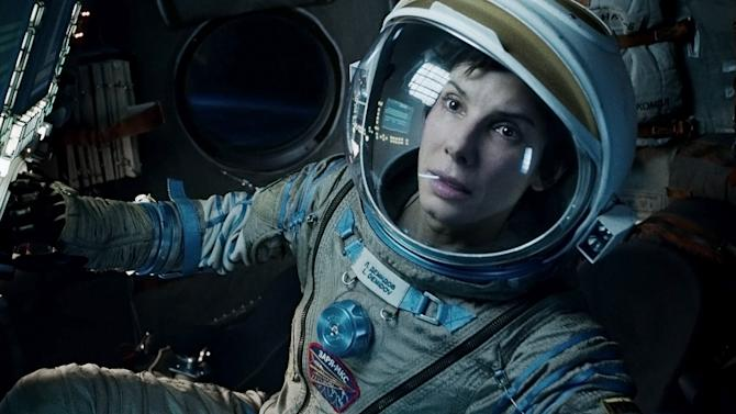 """This film image released by Warner Bros. Pictures shows Sandra Bullock in a scene from """"Gravity."""" Bullock says making the lost-in-space movie directed by Alfonso Cuaron was her """"best life decision"""" ever. (AP Photo/Warner Bros. Pictures)"""