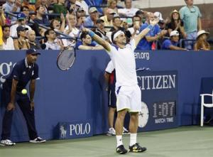 David Ferrer of Spain celebrates match point in defeating Janko Tipsarevic of Serbia at the U.S. Open tennis championships in New York