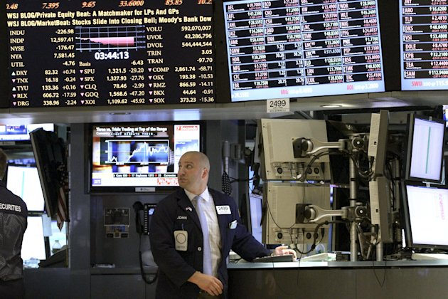 FILE- In this Thursday, June 21, 2012 file photo, a trader works on the floor of the New York Stock Exchange in New York. Wall Street appeared headed for a higher opening, Friday June 22, 2012 a day after the Dow sustained its second-worst loss of the year. Dow Jones industrial futures rose 0.4 percent to 12,546 and S&P 500 futures added 0.4 percent to 1,323.50. (AP Photo/Mary Altaffer, File)