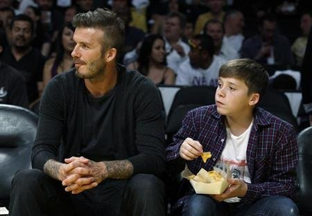 David Beckham and son watch Lakers play Nuggets during playoff game in Los Angeles