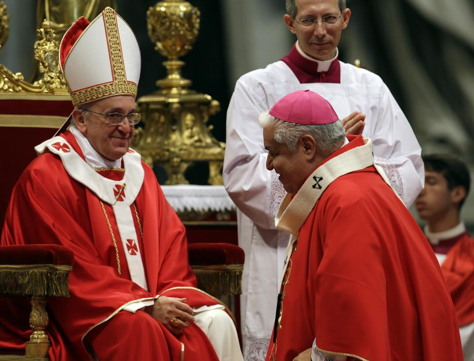 Monsignor Joseph William Tobin, Archbishop of Indianapolis, Indiana, United States, is greeted by Pope Francis after receiving the Pallium, a woolen shawl symbolizing his bond to the pope, during a mass in St. Peter's Basilica, at the Vatican, Saturday, June 29, 2013. (AP Photo/Gregorio Borgia)