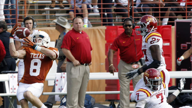 Texas receiver Jaxon Shipley (8) reaches for a tipped pass against Iowa State defensive back Cliff Stokes in the fourth quarter of an NCAA college football game at Darrell K Royal-Memorial Stadium, Saturday, Nov. 10, 2012, in Austin, Texas. Texas won 33-7. (AP Photo/Michael Thomas)