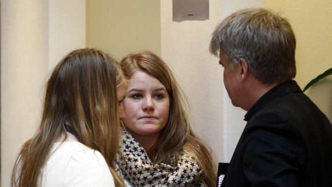 One of the survivors from Utoya, Siri Seim Soenstelie (left), her sister Thea and their father Erik Soenstelie talk at the Oslo courthouse at end of day five  of the ongoing terror- and murder case against Anders Behring Breivik . Siri and her father have  published a book about their experiences. The survivors had a tough day in court Friday, as  Breivik delivered a detailed description of the killings on Utoya island which left 69 people dead.  (AP Photo/ Lise Aserud, Pool)