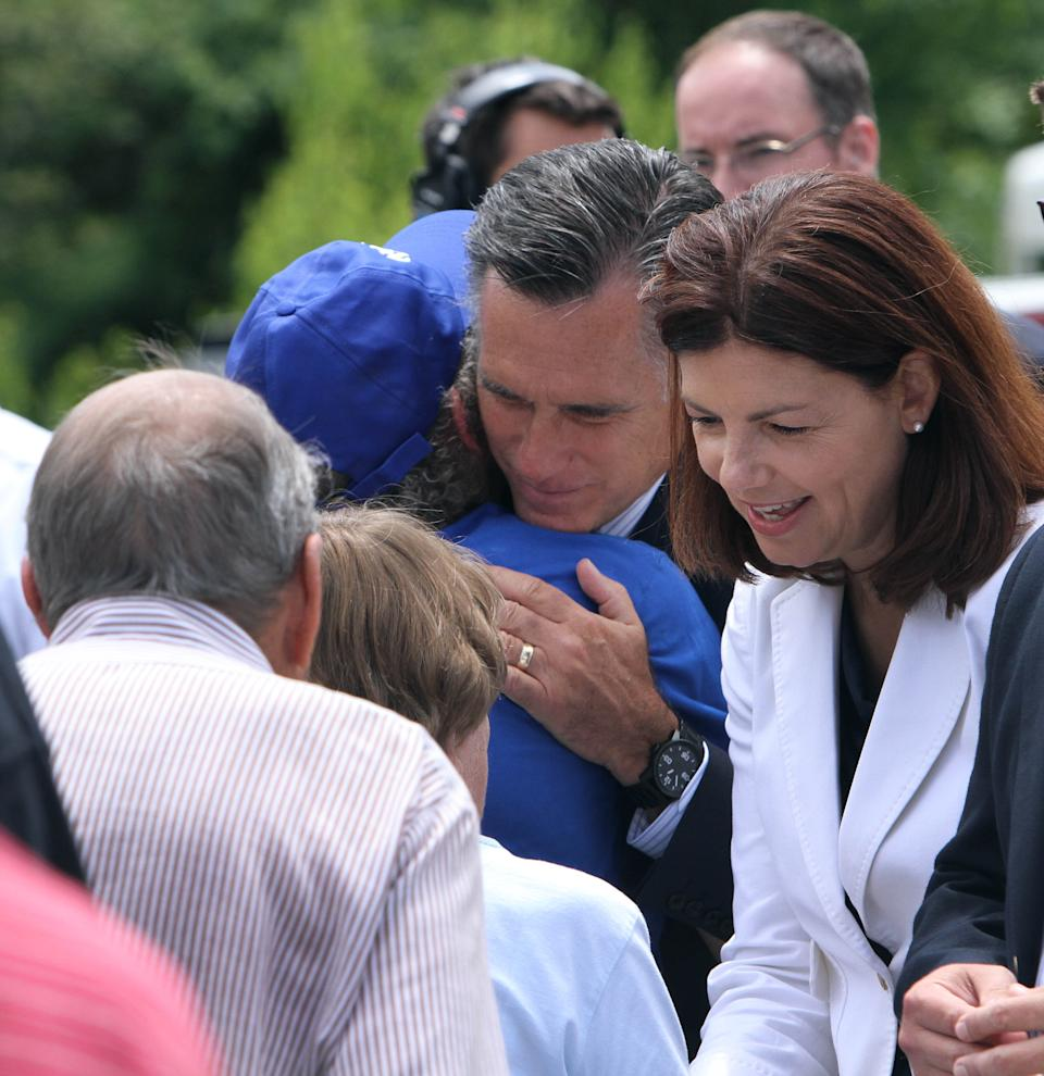 U.S. Sen. Kelly Ayotte, R-N.H., and Republican presidential candidate, former Massachusetts Gov. Mitt Romney greet supporters after Romney spoke about the tragic mass shooting in Colorado during a campaign event in Bow, N.H., Friday, July 20, 2012.  (AP Photo/Jim Cole)