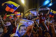 "Supporters of Venezuelan President Hugo Chavez celebrate after receiving news of his reelection in Caracas on October 7. Chavez pledged to become a ""better president"" and work with the opposition after winning a tough re-election battle that betrayed simmering discontent at his socialist revolution"