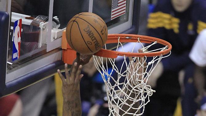 Indiana Pacers' Paul George, left, puts up a shot against Orlando Magic's Glen Davis during the first half of an NBA first-round playoff basketball game Monday, April 30, 2012, in Indianapolis. (AP Photo/Darron Cummings)