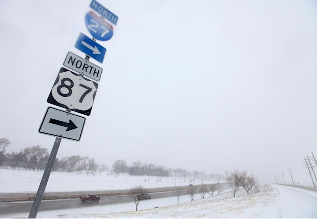 Vehicles navigate along Interstate 27 during blizzard conditions in Lubbock, Texas, Monday, Feb. 25, 2013. State troopers are unable to respond to calls for assistance and National Guard units are mob