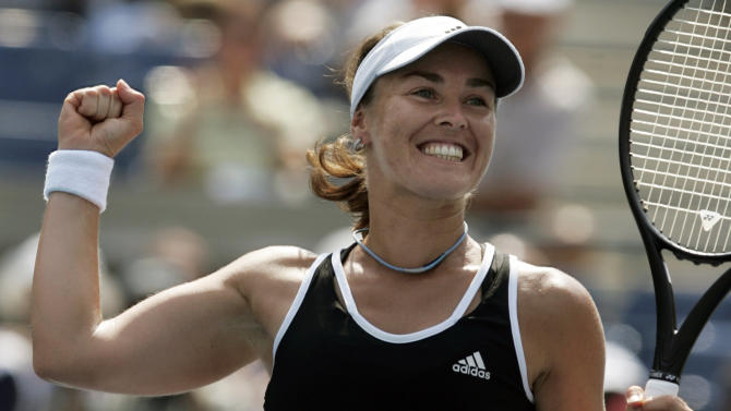 FILE -- In this Aug. 30, 2007 file photo, Swiss tennnis player Martina Hingis celebrates after defeating Pauline Parmentier of France at the US Open tennis tournament in New York.  Five-time Grand Slam singles champion Hingis heads the 2013 class for the International Tennis Hall of Fame. The other new members of the Hall announced Monday, March 4, 2013 are Cliff Drysdale, Charlie Pasarell, and Ion Tiriac. Australian player Thelma Coyne Long's election was announced earlier. (AP Photo/Julie Jacobson, File)