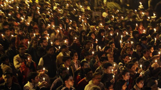 Indians march the streets while holding candles as they mourn the death of a gang rape victim in New Delhi, India, Saturday, Dec. 29, 2012. Indian police charged six men with murder on Saturday, adding to accusations that they beat and gang-raped the woman on a New Delhi bus nearly two weeks ago in a case that shocked the country. The murder charges were laid after the woman died earlier Saturday in a Singapore hospital where she has been flown for treatment. (AP Photo/Altaf Qadri)
