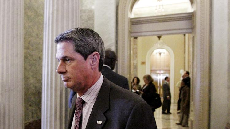 "FILE - In this Dec. 15, 2010 photo, Sen. David Vitter, R-La., walks near the floor of the Senate during the votes on tax cuts legislation on Capitol Hill in Washington.  Vitter calls subsidies for renewable energy projects ""reckless,"" but he has sought money from the program for his home state.   (AP Photo)"
