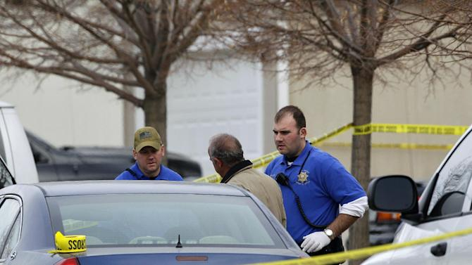 """Police investigators work at the scene of an apparent murder-suicide, which officials say left four dead inside a home, according to officials, in Longmont, Colo., Tuesday Dec. 18, 2012.  Weld County sheriff's spokesman Tim Schwartz says dispatchers heard the woman who called 911 scream """"No, no, no,"""" and then they heard a gunshot. Schwartz says a man grabbed the phone and said he was going to kill himself, and dispatchers heard another shot.  (AP Photo/Brennan Linsley)"""