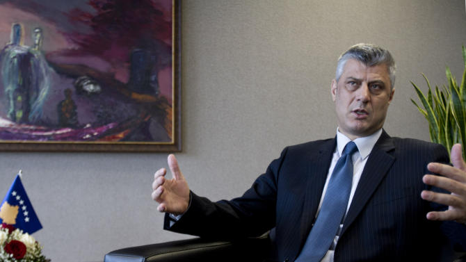 Kosovo Prime Minister Hashim Thaci gestures during an interview with The Associated Press in the capital Pristina, prior to heading to Brussels for EU mediating talks with Serbia, Wednesday, Jan. 16, 2013. Hashim Thaci has ruled out granting autonomy to Serbs in the country's north in exchange for Serbia's support in getting a seat in the United Nations. (AP Photo/Visar Kryeziu)