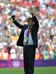 Mexico's coach Luis Fernando Tena celebrates after winning the men's football final match between Brazil and Mexico at Wembley stadium during the London 2012 Olympic Games on August 11, 2012 in London. Mexico won 2-1. AFP PHOTO / KHALED DESOUKI
