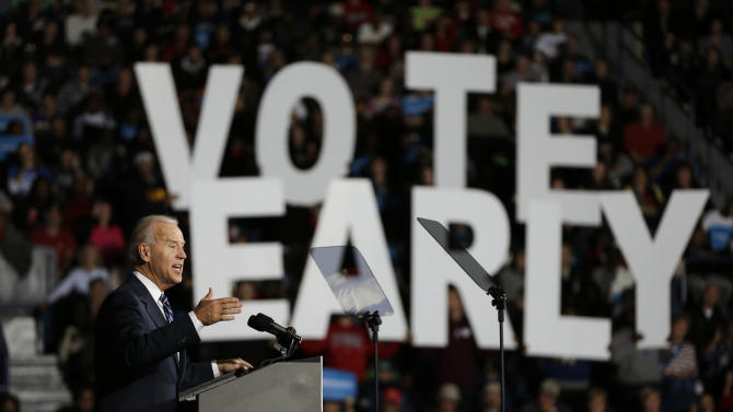 "FILE - This Oct. 29, 2012 file photo shows Vice President Joe Biden speaking in front of  ""Vote Early"" sign during a campaign rally at the Covelli Centre, Monday, in Youngstown, Ohio. One week before a close election, superstorm Sandy has confounded the presidential race, halting early voting in many areas, forcing both candidates to suspend campaigning and leading many to ponder whether the election might be postponed.  It could take days to restore electricity to all of the more than 8 million homes and businesses that lost power when the storm pummeled the East Coast. That means it's possible that power could still be out in some states on Election Day _ a major problem for areas that rely on electronic voting machines.   (AP Photo/Matt Rourke, File)"