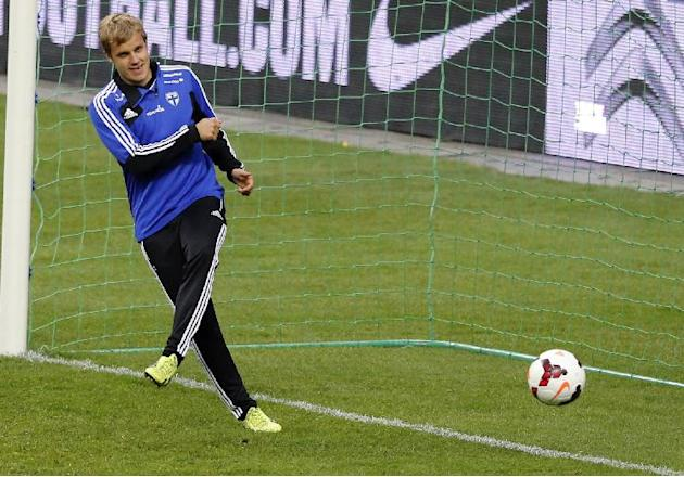 Finland's Prparim Hetemaj attends a training session at the Stade de France stadium in Saint Denis, north of Paris, Monday, Oct. 14, 2013, ahead of their 2014 World Cup Group I qualifying soccer match