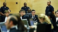 Congolese warlord Thomas Lubanga (C) hears the first-ever sentence delivered by The International Criminal Court (ICC) in the Hague. The International Criminal Court jailed Lubanga for 14 years Tuesday for using child soldiers in his rebel army, the first sentence to be handed down by the world's only permanent war crimes tribunal