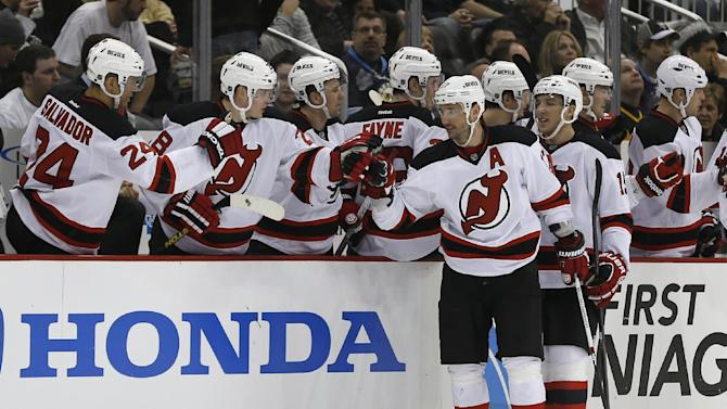 New Jersey Devils' Ilya Kovalchuk, center, is greeted by teammates on the bench after scoring in the second period of the NHL hockey game against the Pittsburgh Penguins Sunday, Feb. 10, 2013, in Pittsburgh. (AP Photo/Keith Srakocic)