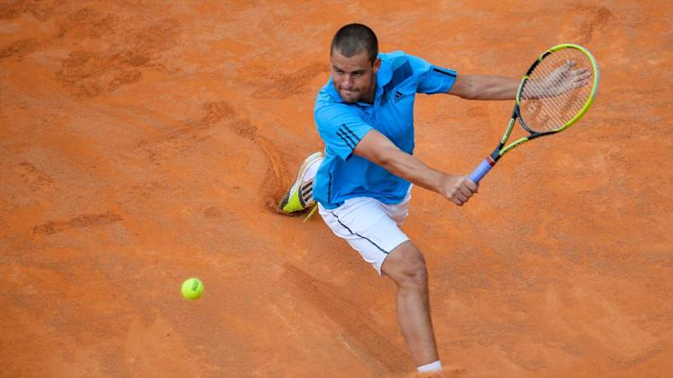 Russia's Mikhail Youzhny returns the ball to Spain's player Rafael Nadal during the Rome Masters Tennis match on May 15, 2014, at the Foro Italico in Rome