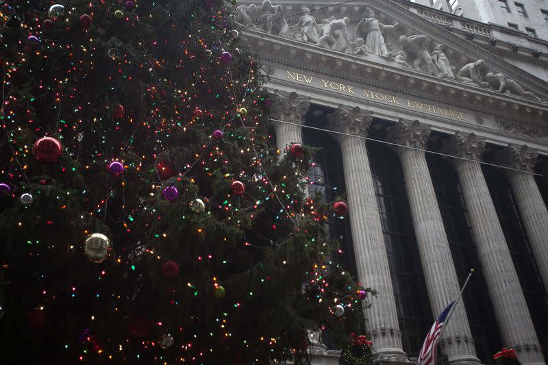 Wall St. ends flat in short session, Dow ekes out record close