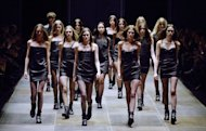Models present creations for Saint Laurent during the Fall/Winter 2013-2014 ready-to-wear collection show on March 4, 2013 in Paris. Designer Hedi Slimane on Monday unveiled his keenly anticipated second women's collection for Saint Laurent after a debut that ruffled feathers, divided the fashion world and apparently exposed a debate about who was first to show the skinny suit