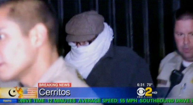 FILE - In this Sept. 15, 2012 file image from video provided by CBS2-KCAL9, Nakoula Basseley Nakoula, the man behind a crudely produced anti-Islamic video that has inflamed parts of the Middle East, is escorted by Los Angeles County sheriff&#39;s deputies from his home in Cerritos, Calif. Nakoula, 55, was arrested Thursday for violating terms of his probation, authorities said. (AP Photo/CBS2-KCAL9, File) MANDATORY CREDIT CBS-KCAL9, LOS ANGELES OUT, LOS ANGELES TV OUT