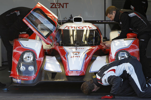 The new Toyota Motorsport GmbH car  for Le Mans 24 hours is prepared before a presentation to the press at the southern France circuit of Le Castellet, near Marseille, Wednesday, Jan. 25, 2012. (AP Ph