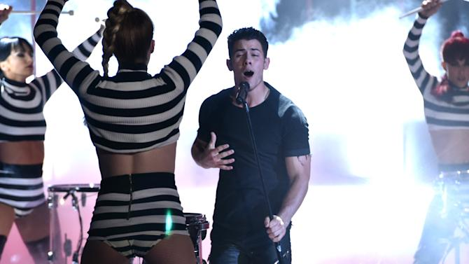 Nick Jonas, right, performs at the iHeartRadio Music Awards at The Shrine Auditorium on Sunday, March 29, 2015, in Los Angeles.  (Photo by John Shearer/Invision for iHeartRadio/AP Images)