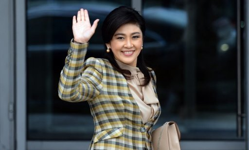 Thai Prime Minister Yingluck Shinawatra, pictured here in September, on Sunday faced a no-confidence debate launched by her opponents in parliament, a day after political protests turned violent in Bangkok.