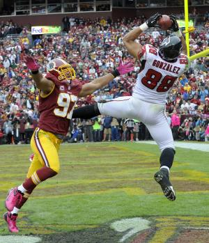 Atlanta Falcons tight end Tony Gonzalez pulls in a touchdown pass under pressure from Washington Redskins linebacker Lorenzo Alexander during the first half of an NFL football game in Landover, Md., Sunday, Oct. 7, 2012. (AP Photo/Susan Walsh)