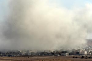 Smoke and dust from an airstrike by the US-led coalition…