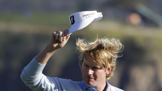 Brandt Snedeker raises his visor on the 18th green of the Pebble Beach Golf Course after winning the AT&T Pebble Beach Pro-Am golf tournament, Sunday, Feb. 10, 2013, in Pebble Beach, Calif. (AP Photo/Eric Risberg)