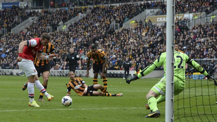 Arsenal's Podolski scores a second goal against Hull City during their English Premier League soccer match at the KC Stadium in Hull