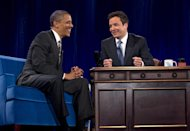 President Barack Obama talks with Jimmy Fallon during commercial break as he participates in a taping of the Jimmy Fallon Show, Tuesday, April 24, 2012, at the University of North Carolina at Chapel Hill, N.C.. (AP Photo/Carolyn Kaster)