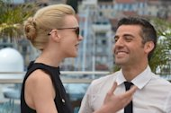 "British actress Carey Mulligan (L) and US actor Oscar Isaac laugh on May 19, 2013 during a photocall for the film ""Inside Llewyn Davis"" at the 66th edition of the Cannes Film Festival in Cannes"
