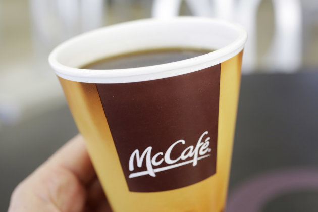 Coffee served in a foam cup is held for an illustration Thursday, Feb. 14, 2013 at a McDonald's restaurant in New York. New York Mayor Michael Bloomberg, who has taken on smoking, sugary drinks and sa