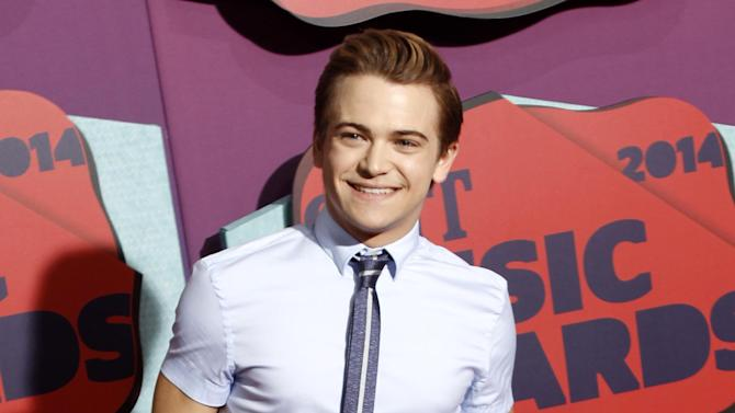 """FILE - This June 4, 2014 file photo shows Hunter Hayes at the CMT Music Awards at Bridgestone Arena in Nashville, Tenn. Hayes is set to join MTKO, the Vamps and other acts at the U.S. Open's annual Arthur Ashe Kids' Day. The """"Wanted"""" singer said in a statement Wednesday that he's honored to be part of the Aug. 23 event at the Billie Jean King National Tennis Center in Queens, New York, where the last Grand Slam of the year is held in tennis. (Photo by Wade Payne/Invision/AP, File)"""