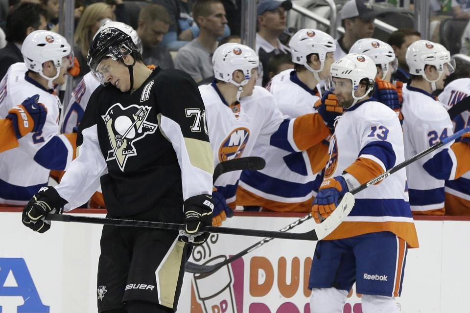 New York Islanders' Colin McDonald (13) celebrates his goal with teammates as Pittsburgh Penguins' Evgeni Malkin (71) skates back to his bench during the second period of Game 2 of an NHL hockey Stanley Cup first-round playoff series, Friday, May 3, 2013, in Pittsburgh. (AP Photo/Gene J. Puskar)