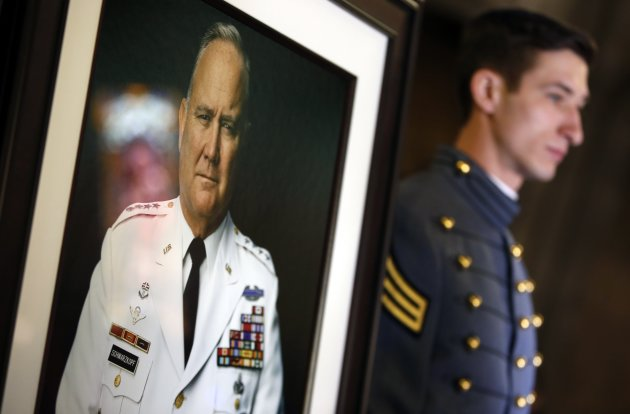 U.S. Military Academy Senior Cadet Mark Castelli from Carmel New York, stands next to a portrait of the late U.S. Four Star General H. Norman Schwarzkopf at the entrance to the Cadet Chapel at the United States Military Academy at West Point, before Schwarzkopf's funeral service February 28, 2013. Schwarzkopf, who graduated from West Point in 1956, commanded the U.S.-led international coalition that drove Saddam Hussein's forces out of Kuwait in 1991. He was 78 when he died in Tampa, Florida on December 27, 2012 of complications from pneumonia.  REUTERS/Mike Segar    (UNITED STATES - Tags: MILITARY OBITUARY SOCIETY POLITICS TPX IMAGES OF THE DAY)
