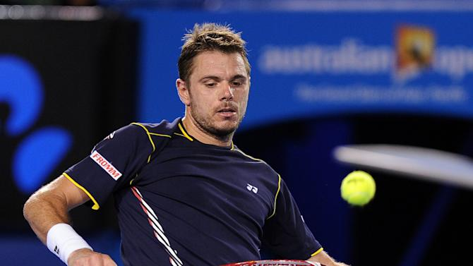 Switzerland's Stanislas Wawrinka kicks a ball during his fourth round match against Serbia's Novak Djokovic at the Australian Open tennis championship in Melbourne, Australia, Sunday, Jan. 20, 2013.  (AP Photo/Andrew Brownbill)