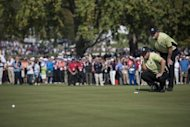 Team Europe&#39;s Nicolas Colsaerts and Lee Westwood line up a put on the 11th green during the afternoon Four Ball Match on the first day of the 39th Ryder Cup at the Medinah Country Club in Medinah, Illinois