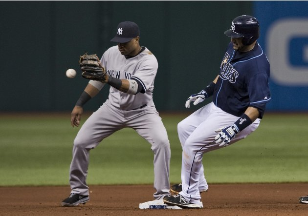Tampa Bay Rays' Molina reaches second base with double ahead of the throw to New York Yankees' Cano during fifth inning of a MLB American League baseball game in St. Petersburg