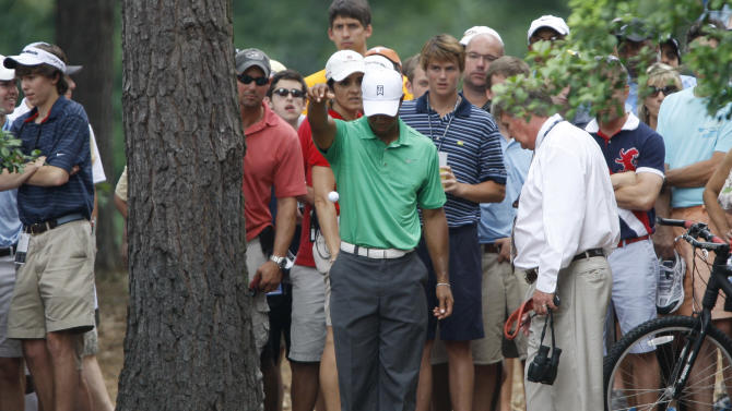 Tiger Woods takes a drop on the fifth hole during the second round of the Wells Fargo Championship golf tournament at Quail Hollow Club in Charlotte, N.C., Friday, May 4, 2012. (AP Photo/Nell Redmond)