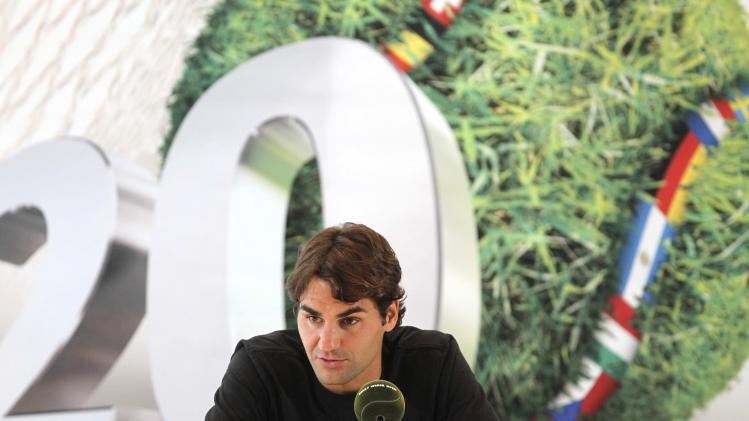 Swiss Roger Federer attends a press conference after his semifinal tennis match against  Russia's Mikhail Youzhny at the Gerry Weber Open ATP tennis tournament in Halle, western Germany, Saturday June 16, 2012. (AP Photo/dapd/Joerg Sarbach)