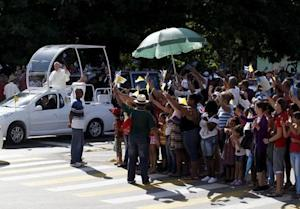 Pope Francis waves to the crowd in Holguin