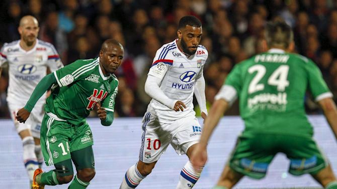 Olympique Lyon's Lacazette challenges Saint-Etienne's N'Guemo during their French Ligue 1 soccer match in Lyon