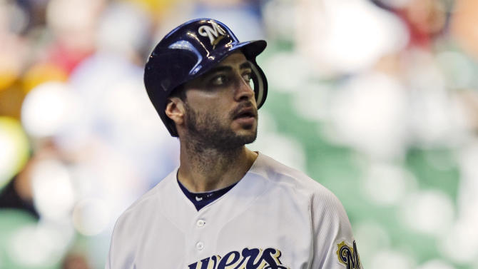 FILE - In this Sept. 30, 2012, file photo, Milwaukee Brewers' Ryan Braun walks off the field after striking out to end the game in the Brewers' 8-0 loss to the Houston Astros in a baseball game in Milwaukee. Braun says he used the person who ran the Florida clinic now under investigation by Major League Baseball as a consultant on his drug suspension appeal last year and nothing more.  Yahoo Sports reported Tuesday, Feb. 5, 2012, that his name showed up three times in records of the Biogenesis of America LLC clinic.   (AP Photo/Andy Manis, File)