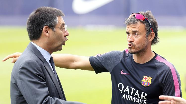 FC Barcelona president Bartomeu and coach Enrique speak during a training session at Joan Gamper training camp, near Barcelona